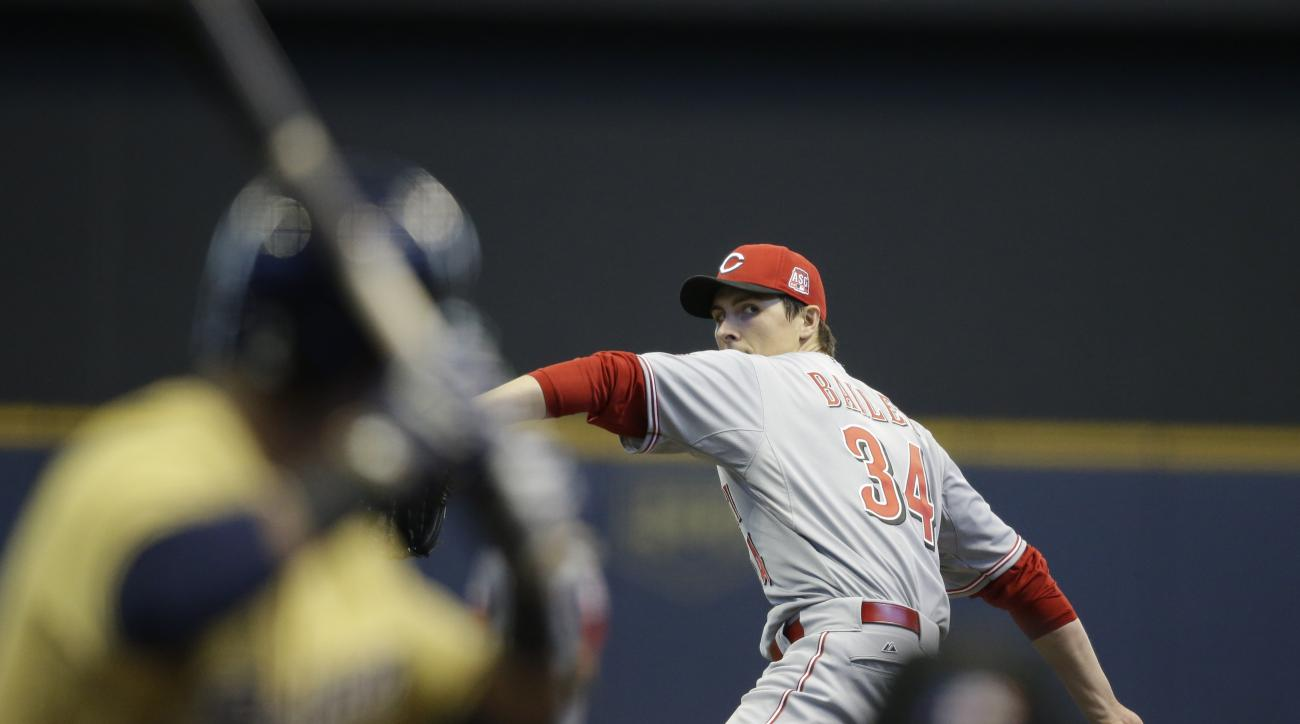 Cincinnati Reds starting pitcher Homer Bailey throws to the Milwaukee Brewers during the first inning of a baseball game Thursday, April 23, 2015, in Milwaukee. (AP Photo/Jeffrey Phelps)
