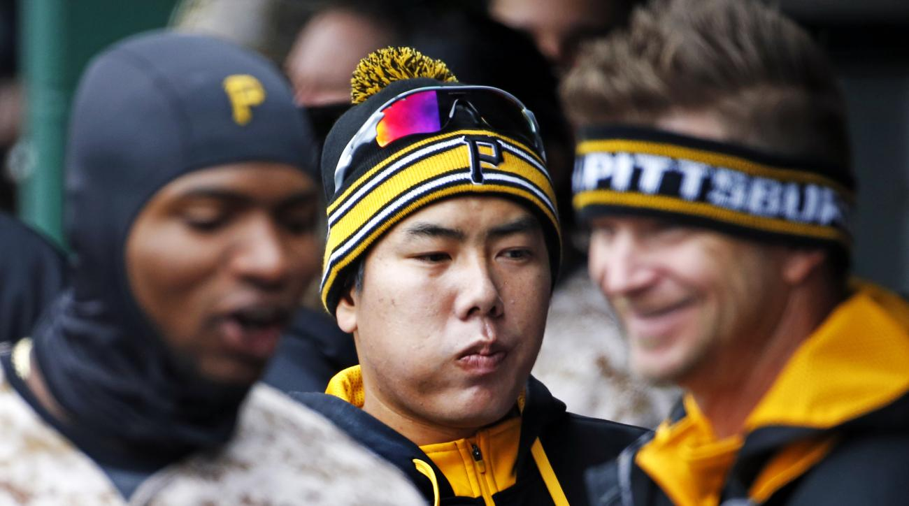 Wearing headgear reflecting the cool temperatures, Pittsburgh Pirates' Gregory Polanco, left, Jung Ho Kang, center, of South Korea, and A.J. Burnett celebrate a solo-home run by Pirates' Sean Rodriguez in the second inning of a baseball game against the C