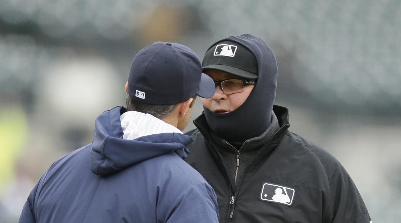 Detroit Tigers manager Brad Ausmus, left, discusses a ruling with umpire Gerry Davis during the sixth inning of a baseball game against the New York Yankees, Thursday, April 23, 2015, in Detroit. (AP Photo/Carlos Osorio)