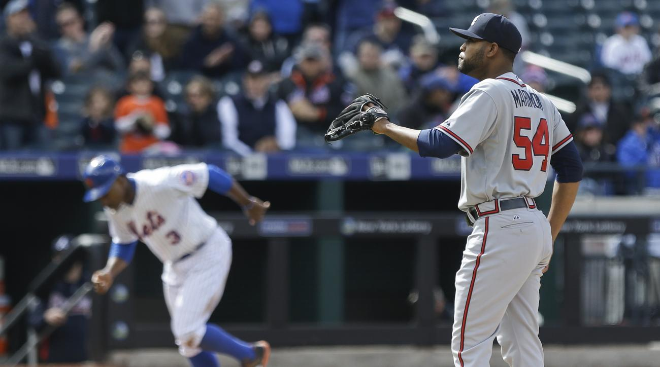 Atlanta Braves starting pitcher Sugar Ray Marimon (54) reacts as New York Mets' Curtis Granderson (3) heads to home plate after Marimon walked in a run during the fifth inning of a baseball game Thursday, April 23, 2015, in New York.  (AP Photo/Frank Fran