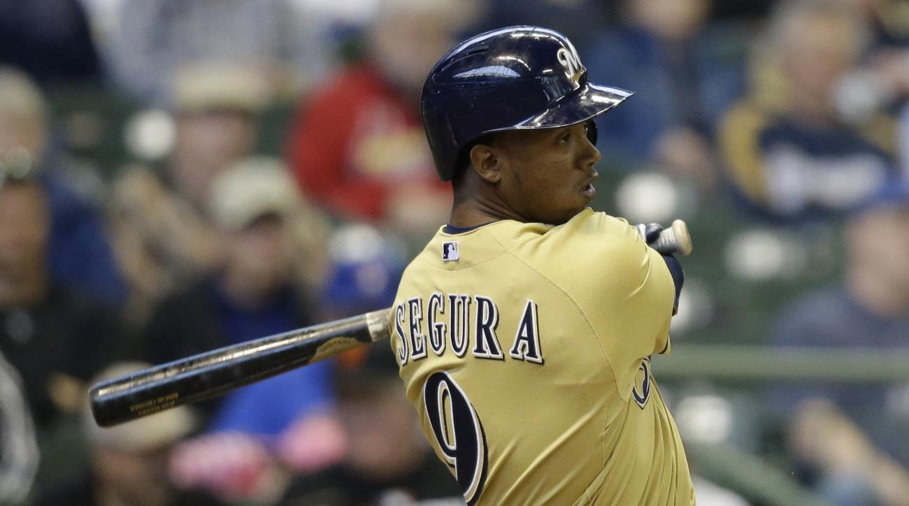 Milwaukee Brewers' Jean Segura hits a run-scoring single against the Cincinnati Reds during the seventh inning of a baseball game Thursday, April 23, 2015, in Milwaukee. (AP Photo/Jeffrey Phelps)