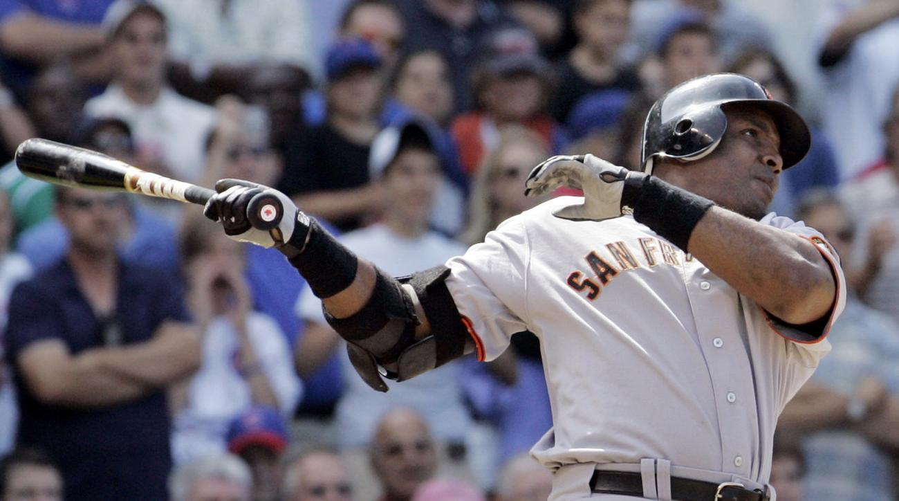 FILE - In this July 19, 2007, file photo, San Francisco Giants' Barry Bonds hits a three-run home run during the seventh inning of a baseball game against the Chicago Cubs in Chicago. Barry Bonds, Roger Clemens have moved on, their names cleared. Still, t