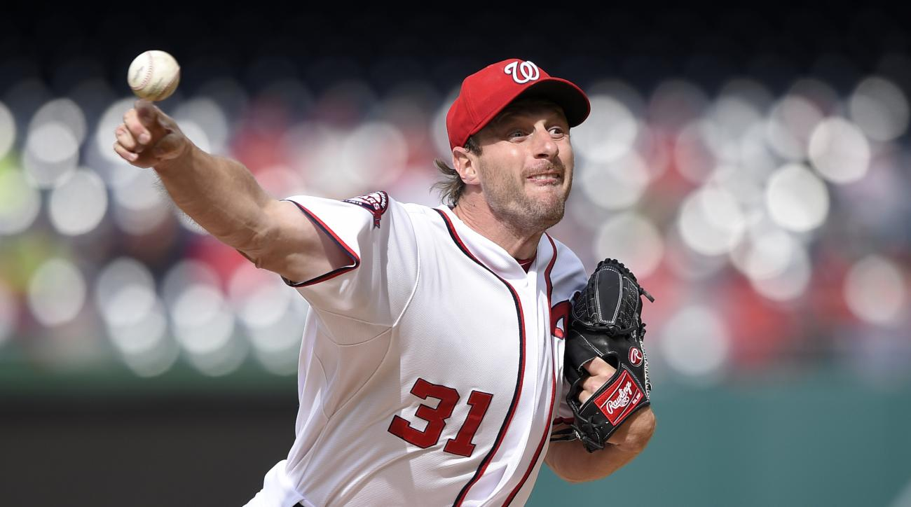 Washington Nationals starting pitcher Max Scherzer delivers a pitch against the St. Louis Cardinals during the first inning of a baseball game, Thursday, April 23, 2015, in Washington. (AP Photo/Nick Wass)