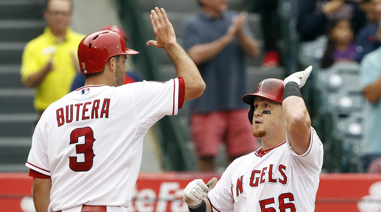 Los Angeles Angels' Drew Butera, left, congratulates Kole Calhoun (56) for hitting a two-run home run against the Oakland Athletics during the third inning of a baseball game in Anaheim, Calif., Thursday, April 23, 2015. (AP Photo/Alex Gallardo)