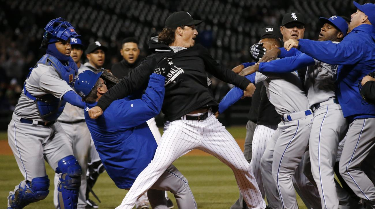 Chicago White Sox's Jeff Samardzija, center, fights with Kansas City Royals players during the seventh inning of a baseball game Thursday, April 23, 2015, in Chicago. (AP Photo/Andrew A. Nelles)