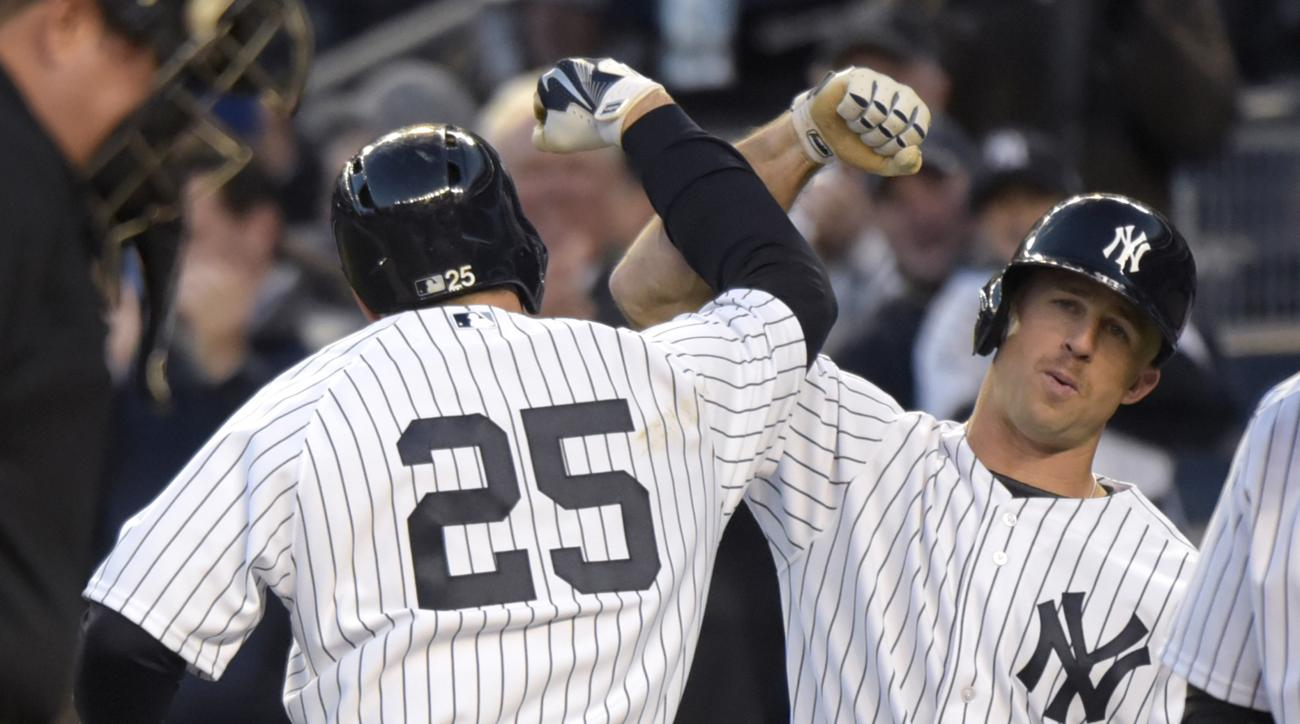 New York Yankees' Mark Teixeira (25) celebrates with Brett Gardner after hitting a two-run home run during the first inning of an interleague baseball game against the New York Mets, Friday, April 24, 2015, at Yankee Stadium in New York. (AP Photo/Bill Ko