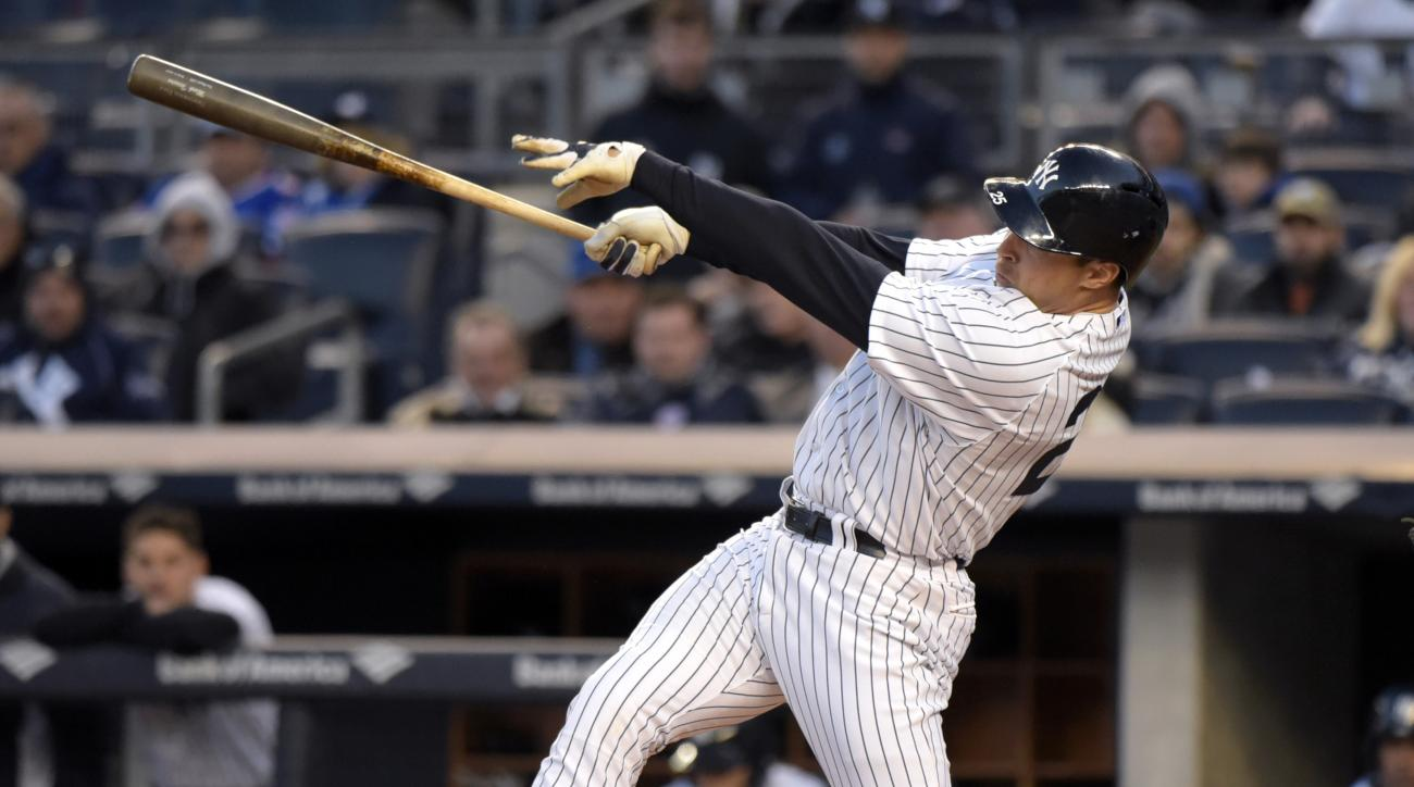 New York Yankees' Mark Teixeira hits a two-run home run during the first inning of an interleague baseball game against the New York Mets, Friday, April 24, 2015, at Yankee Stadium in New York. (AP Photo/Bill Kostroun)
