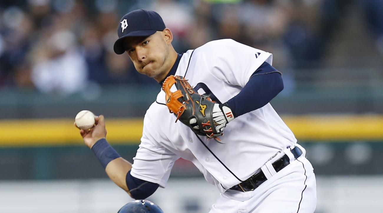 Detroit Tigers shortstop Jose Iglesias, top, throws to first base as Cleveland Indians' David Murphy (7) slides to complete a double play on a Roberto Perez ground ball in the fourth inning of a baseball game in Detroit, Friday, April 24, 2015. (AP Photo/