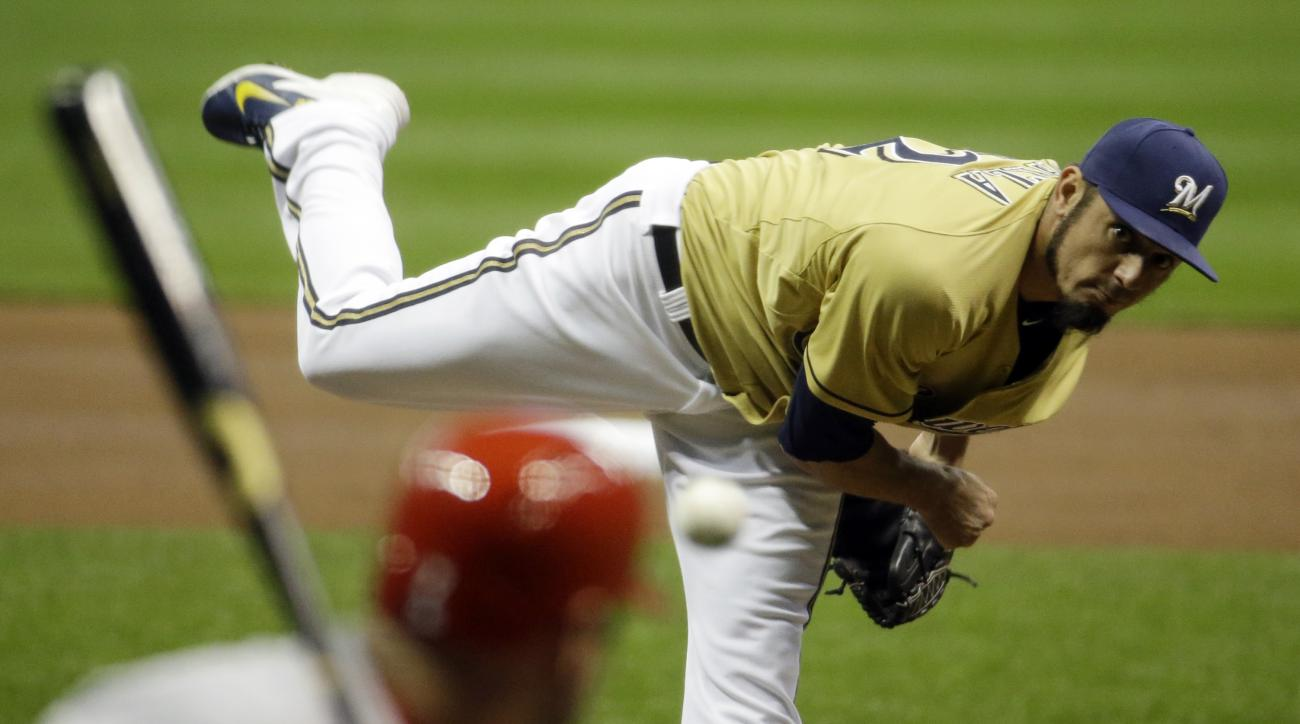Milwaukee Brewers starting pitcher Matt Garza throws during the first inning of a baseball game against the St. Louis Cardinals, Friday, April 24, 2015, in Milwaukee. (AP Photo/Morry Gash)