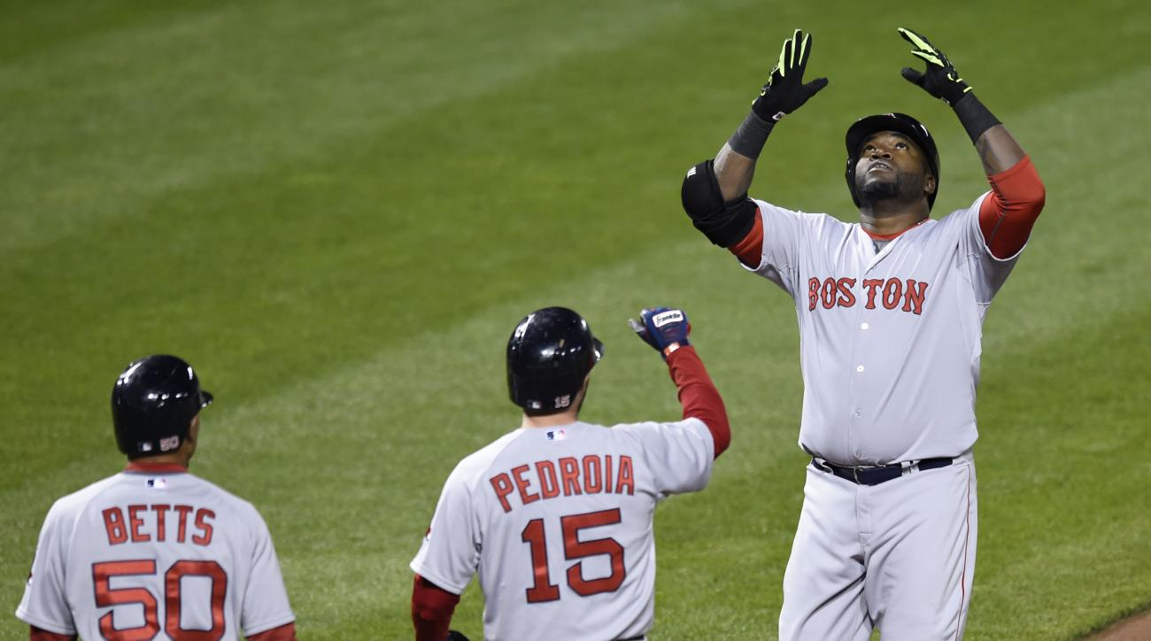 Boston Red Sox's David Ortiz, right, crosses the plate after hitting a three-run home run against the Baltimore Orioles during the fifth inning of a baseball game, as Dustin Pedroia and Mookie Betts wait to congratulate him after scoring on the homer, Fri