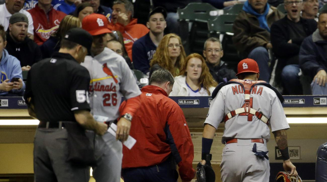 St. Louis Cardinals catcher Yadier Molina (4) leaves the game during the fifth inning of a baseball game against the Milwaukee Brewers, Friday, April 24, 2015, in Milwaukee. (AP Photo/Morry Gash)