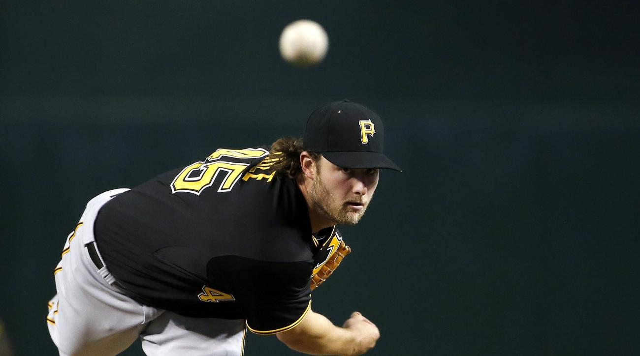 Pittsburgh Pirates' Gerrit Cole warms up during the fifth inning of a baseball game against the Arizona Diamondbacks, Friday, April 24, 2015, in Phoenix. (AP Photo/Ross D. Franklin)