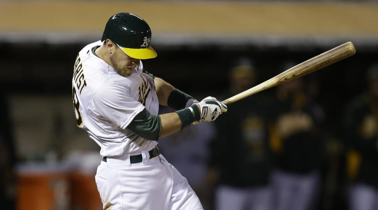 Oakland Athletics' Ben Zobrist bats against the Houston Astros during a baseball game Friday, April 24, 2015, in Oakland, Calif. The A's placed Zobrist on the 15-day disabled list on Saturday, April 25, 2015, with a torn cartilage in his left knee. (AP Ph