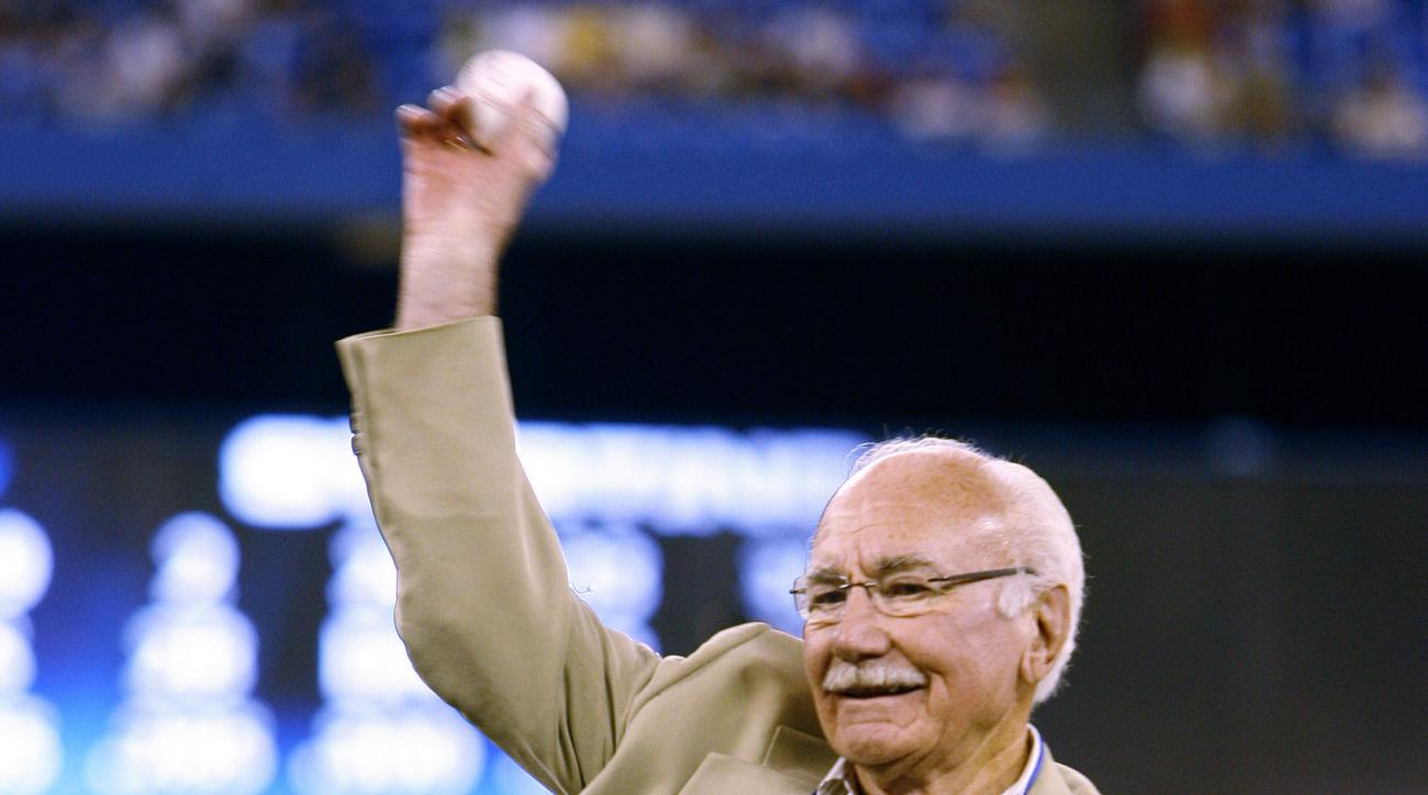 FILE - In this July 25, 2009, file photo, former Major League Baseball great Jim Fanning throws the ceremonial first pitch prior to a baseball game between the Toronto Blue Jays and the Tampa Bay Rays in Toronto. Fanning, the longtime Montreal Expos execu
