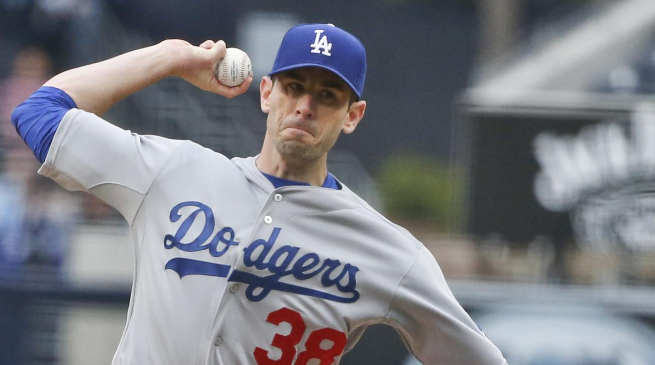 Los Angeles Dodgers starting pitcher Brandon McCarthy works against the San Diego Padres in the first inning of a baseball game Saturday, April 25, 2015, in San Diego. (AP Photo/Lenny Ignelzi)
