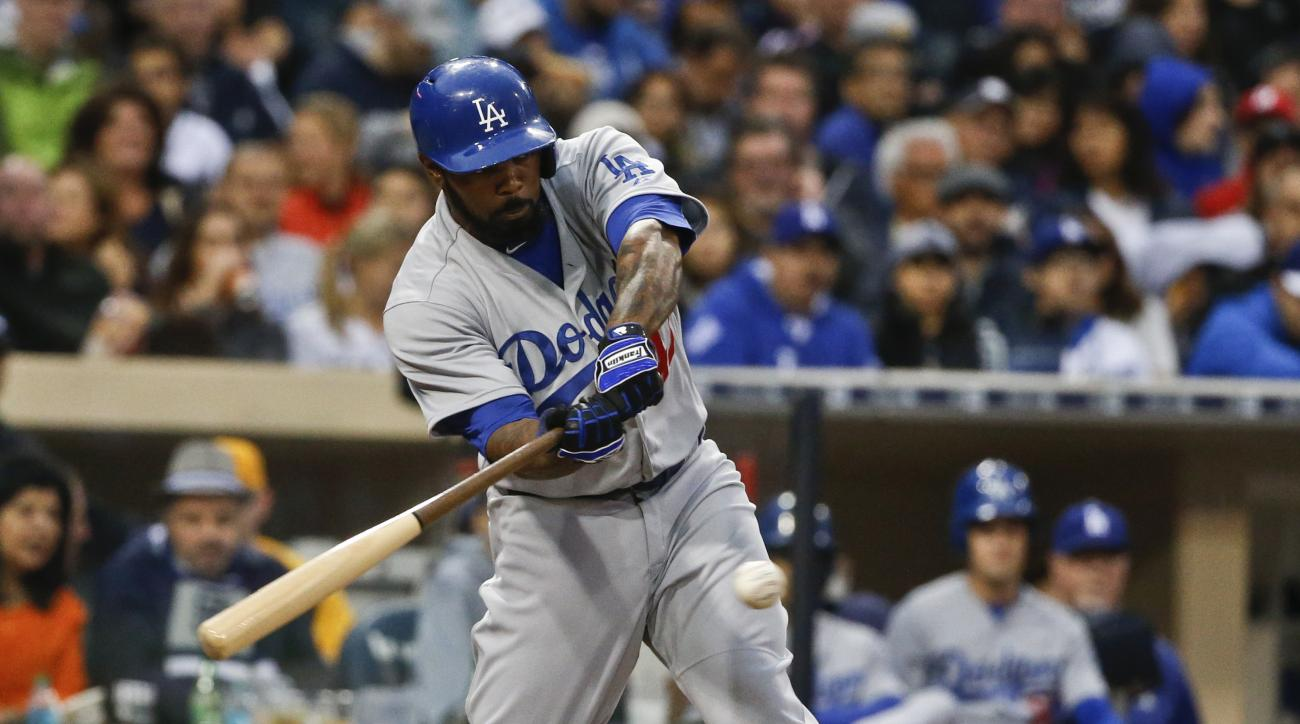 Los Angeles Dodgers' Howie Kendrick swings on a home run during the fifth inning of a baseball game against the San Diego Padres on Saturday, April 25, 2015 in San Diego.   (AP Photo/Lenny Ignelzi)