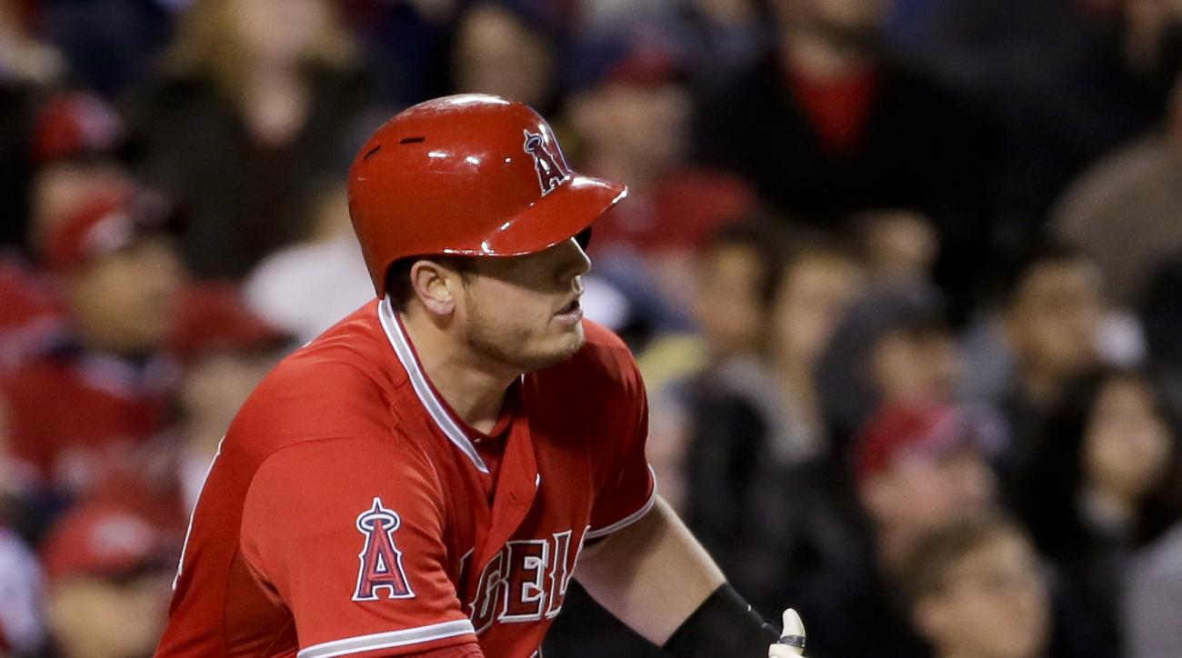 Los Angeles Angels' C.J. Cron watches his two-run singe against the Texas Rangers during the sixth inning of a baseball game in Anaheim, Calif., Saturday, April 25, 2015. (AP Photo/Chris Carlson)