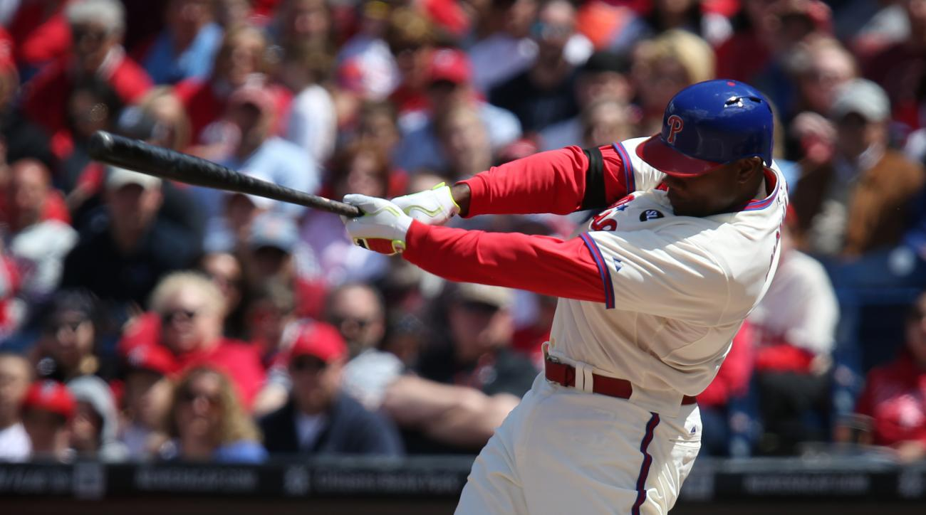 Philadelphia Phillies' Ryan Howard follows through on a three-run home run in the first inning of a baseball game against the Atlanta Braves, Sunday, April 26, 2015, in Philadelphia. (AP Photo/Laurence Kesterson)