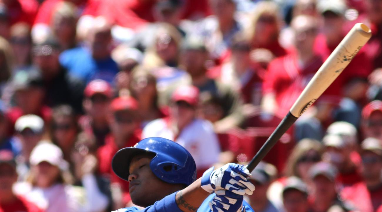 Chicago Cubs' Addison Russell hits a three-run double against the Cincinnati Reds in the fourth inning in a baseball game in Cincinnati, Sunday, April 26, 2015. (AP Photo/Tom Uhlman)