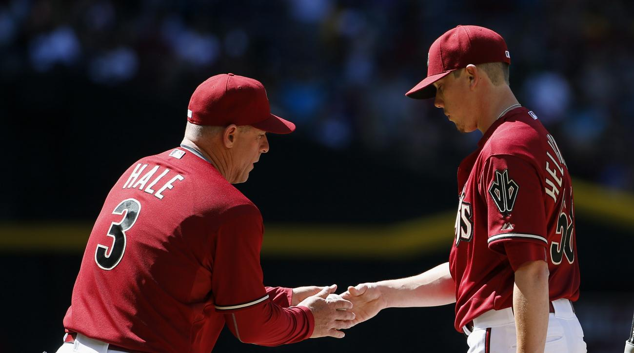 Arizona Diamondbacks' Chip Hale (3) takes the baseball from pitcher Jeremy Hellickson after pulling him from a baseball game during the fifth inning against the Pittsburgh Pirates, Sunday, April 26, 2015, in Phoenix. (AP Photo/Ross D. Franklin)