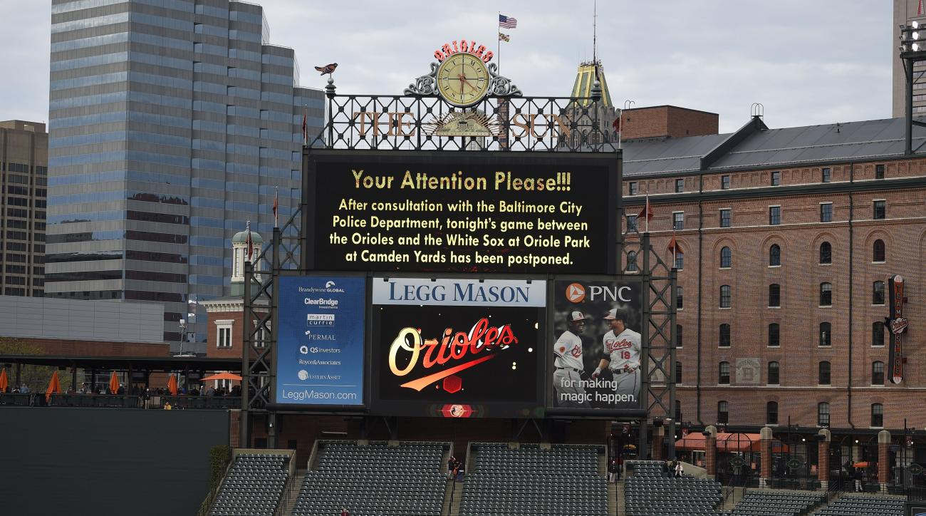 The scoreboard announces that the baseball game between the Baltimore Orioles and the Chicago White Sox is postponed, at Oriole Park at Camden Yards, Monday, April 27, 2015, in Baltimore. (AP Photo/Nick Wass)