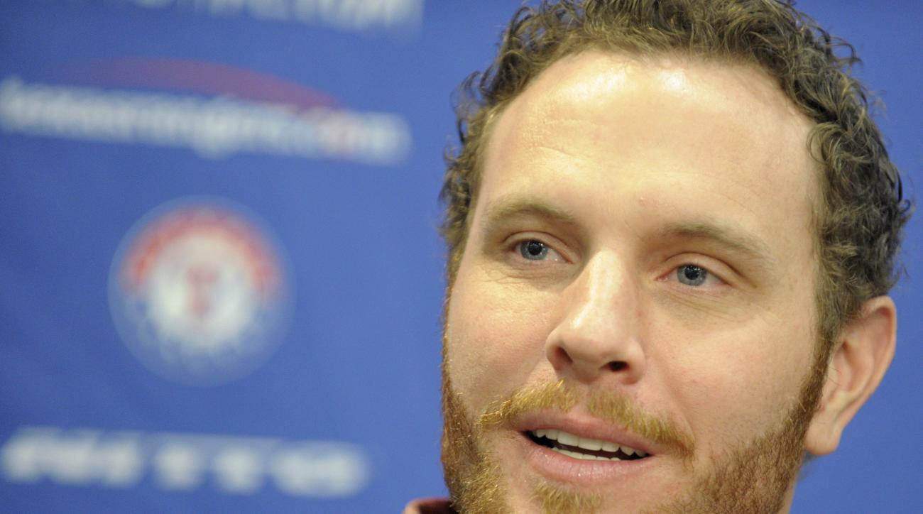 Josh Hamilton attends a press conference at Globe Life Park in Arlington, Texas, Monday, April 27, 2015, announcing that the Texas Rangers reacquired the outfielder from the Los Angeles Angels.  Hamilton is back with the Texas Rangers after two troublesom