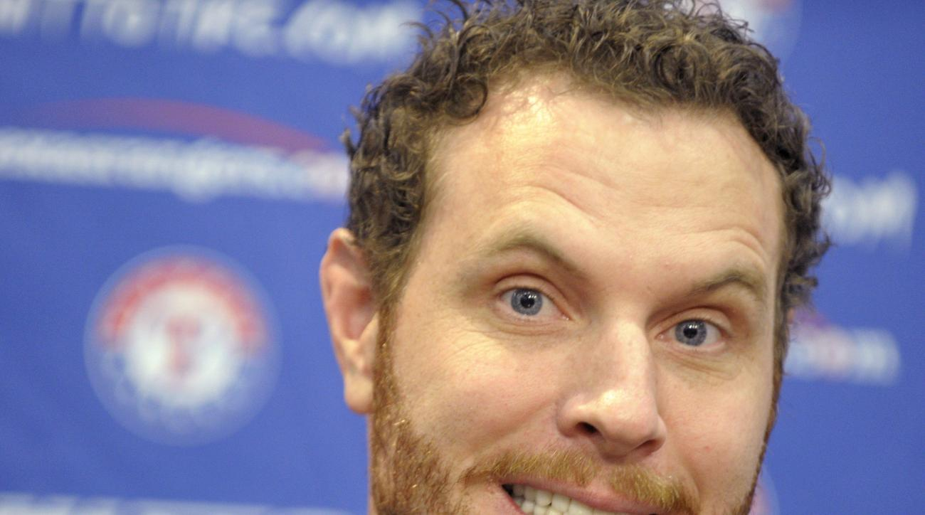 Outfielder Josh Hamilton appears at a press conference    at Globe Life Park in Arlington, Texas, Monday, April 27, 2015, announcing that the Texas Rangers reacquired the outfielder from the Los Angeles Angels.  Hamilton is back with the Texas Rangers aft