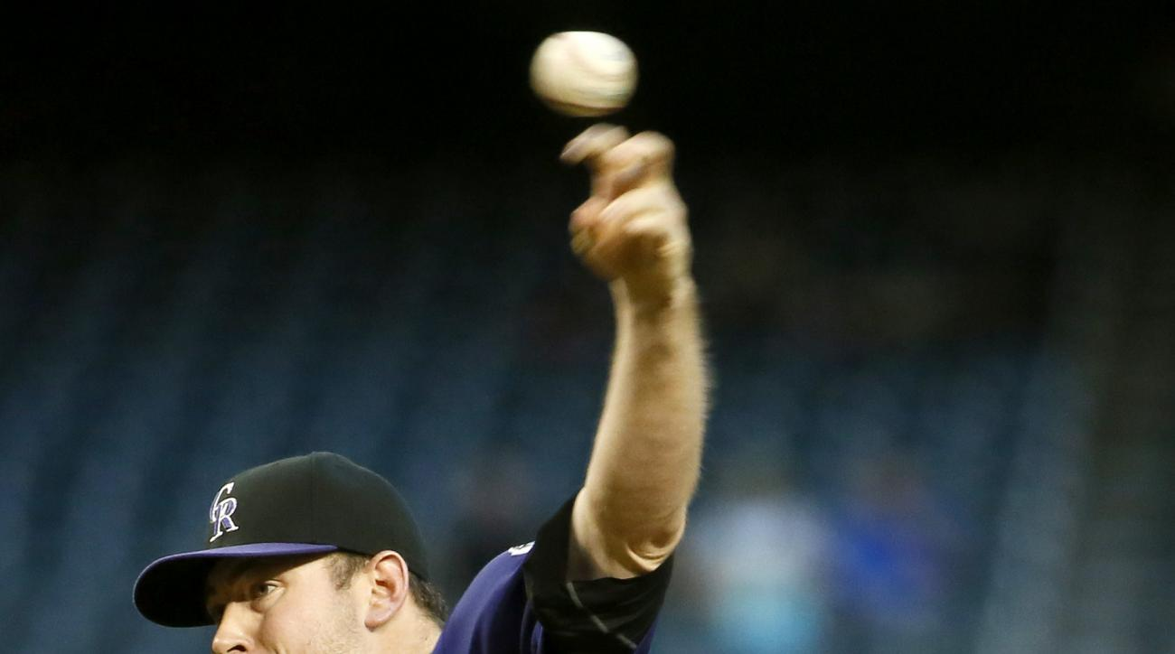 Colorado Rockies Tyler Matzek (15) throws against the Arizona Diamondbacks during the first inning of a baseball game, Monday, April 27, 2015, in Phoenix. (AP Photo/Matt York)