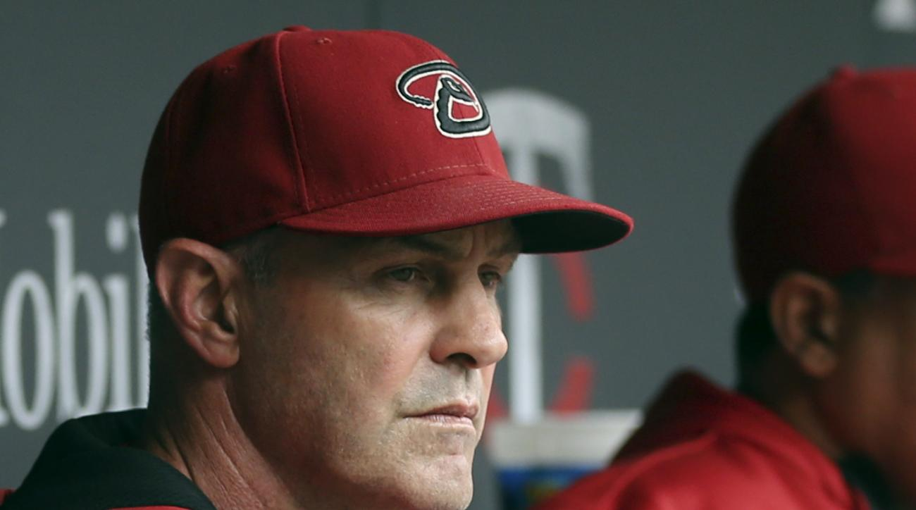 FILE - In this Sept. 24, 2014, file photo,, Arizona Diamondbacks manager Kirk Gibson watches from the dugout during a baseball game against the Minnesota Twins in Minneapolis. The Diamondbacks fired Gibson on Friday, Sept. 26, 2014. (AP Photo/Jim Mone, Fi