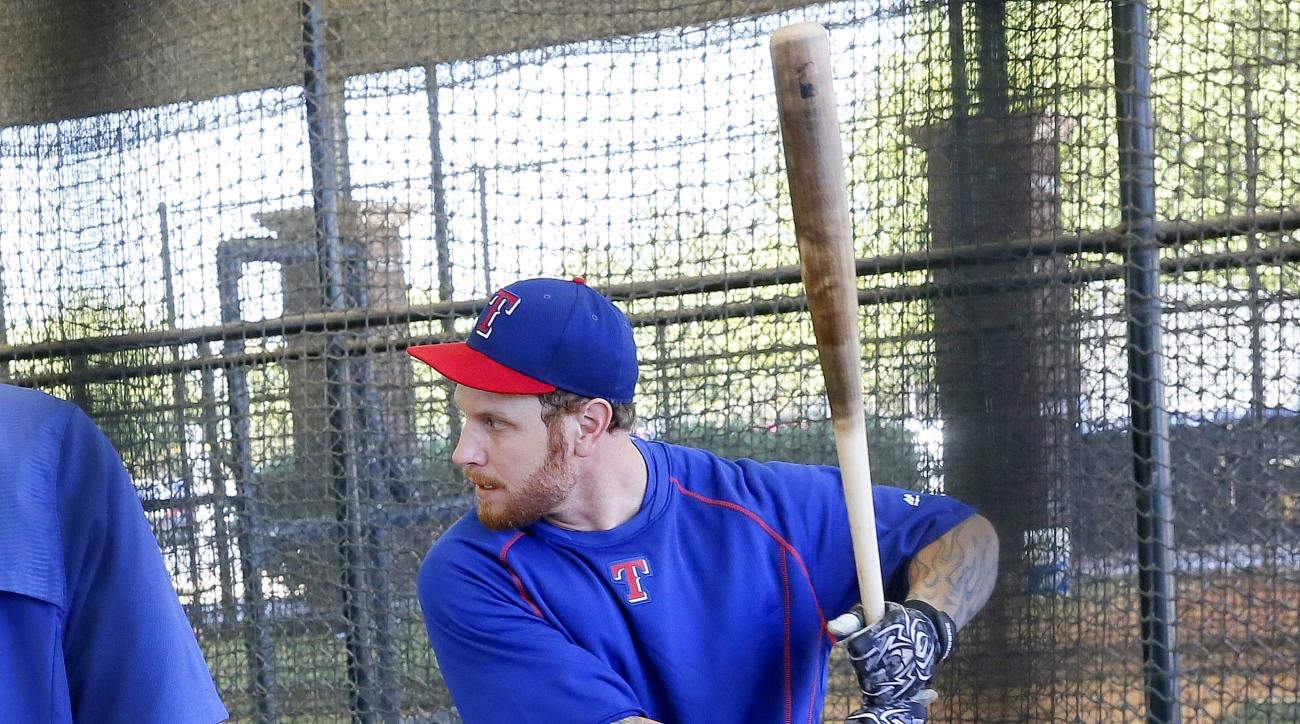 Texas Rangers baseball player Josh Hamilton works out at the Rangers' training facility, Tuesday, April 28, 2015, in Surprise, Ariz. (AP Photo/Matt York)