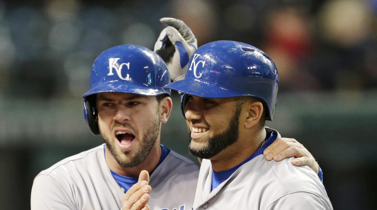 Kansas City Royals' Kendrys Morales, right, is congratulated by Mike Moustakas after Morales hit a three-run home run off Cleveland Indians relief pitcher Bryan Shaw in the seventh inning of a baseball game, Tuesday, April 28, 2015, in Cleveland. Moustaka