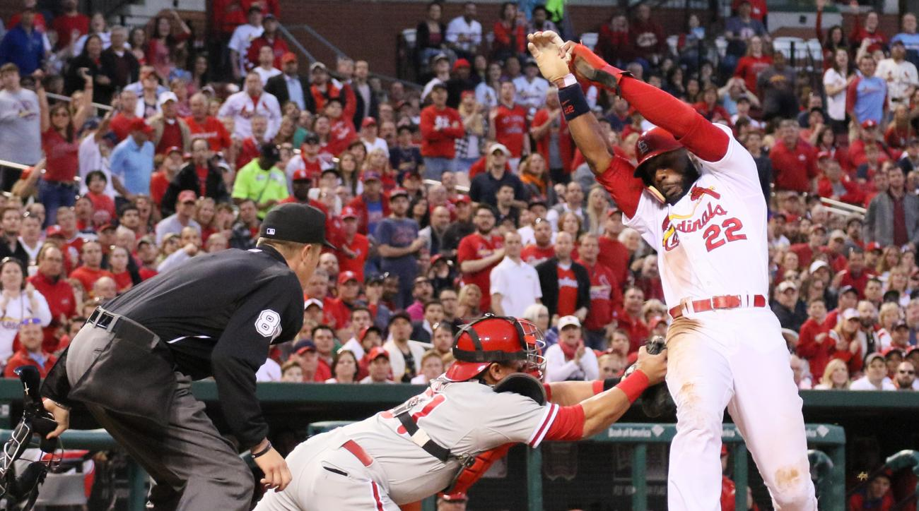St. Louis Cardinals' Jason Heyward is tagged out by Philadelphia Phillies catcher Carlos Ruiz as he tries to score on a single by Kolten Wong in second inning action during a game between the St. Louis Cardinals and the Philadelphia Phillies on Tuesday, A