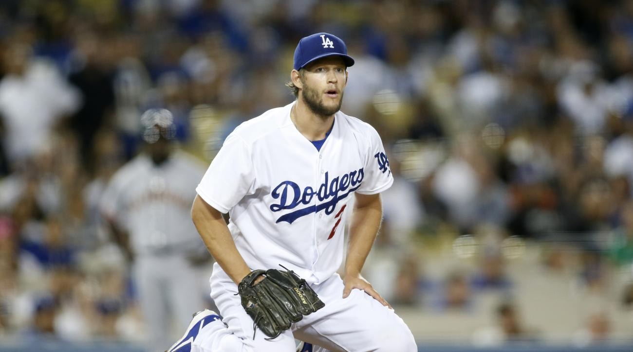Los Angeles Dodgers starting pitcher Clayton Kershaw watches as San Francisco Giants' Casey McGehee is thrown out at first base to end the top of the fourth inning of a baseball game, Tuesday, April 28, 2015, in Los Angeles. (AP Photo/Danny Moloshok)