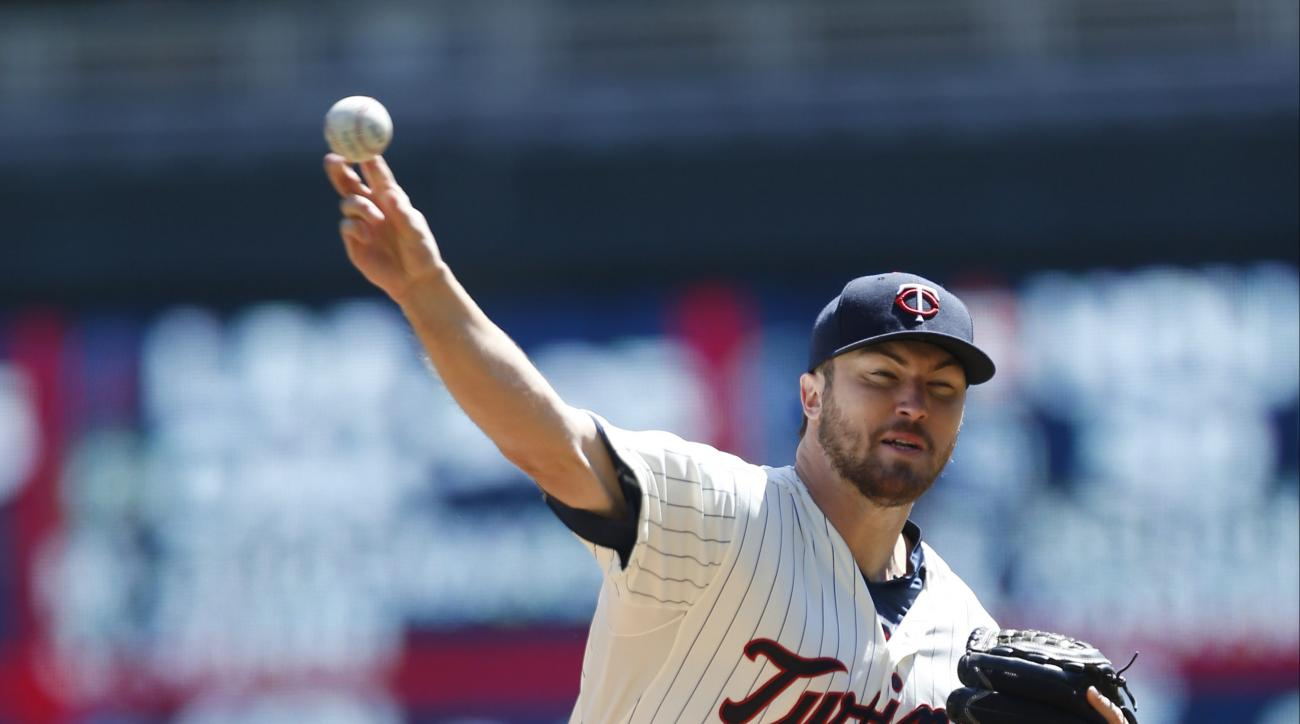 Minnesota Twins pitcher Phil Hughes throws against the Detroit Tigers in the first inning of a baseball game, Wednesday, April 29, 2015, in Minneapolis. (AP Photo/Jim Mone)