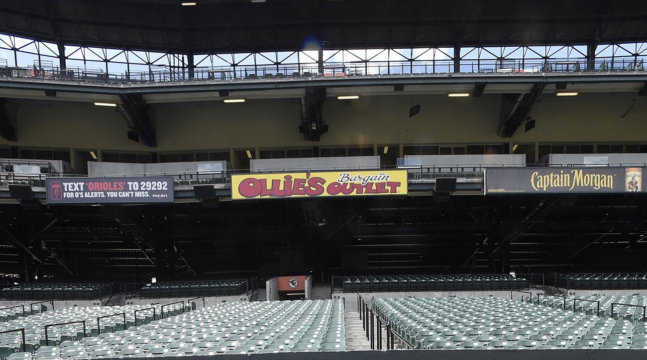 Chicago White Sox catcher Tyler Flowers sits in the dugout of an empty stadium before playing the Baltimore Orioles in a baseball game, Wednesday, April 29, 2015, in Baltimore. Due to security concerns the game was closed to the public. (AP Photo/Gail Bur