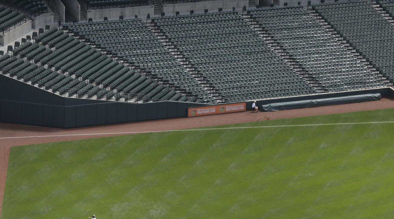 Baltimore Orioles right fielder Delmon Young fields a single by Chicago White Sox's Avisail Garcia in the second inning of a baseball game, Wednesday, April 29, 2015, in Baltimore. The game was played in an empty Oriole Park at Camden Yards amid unrest in