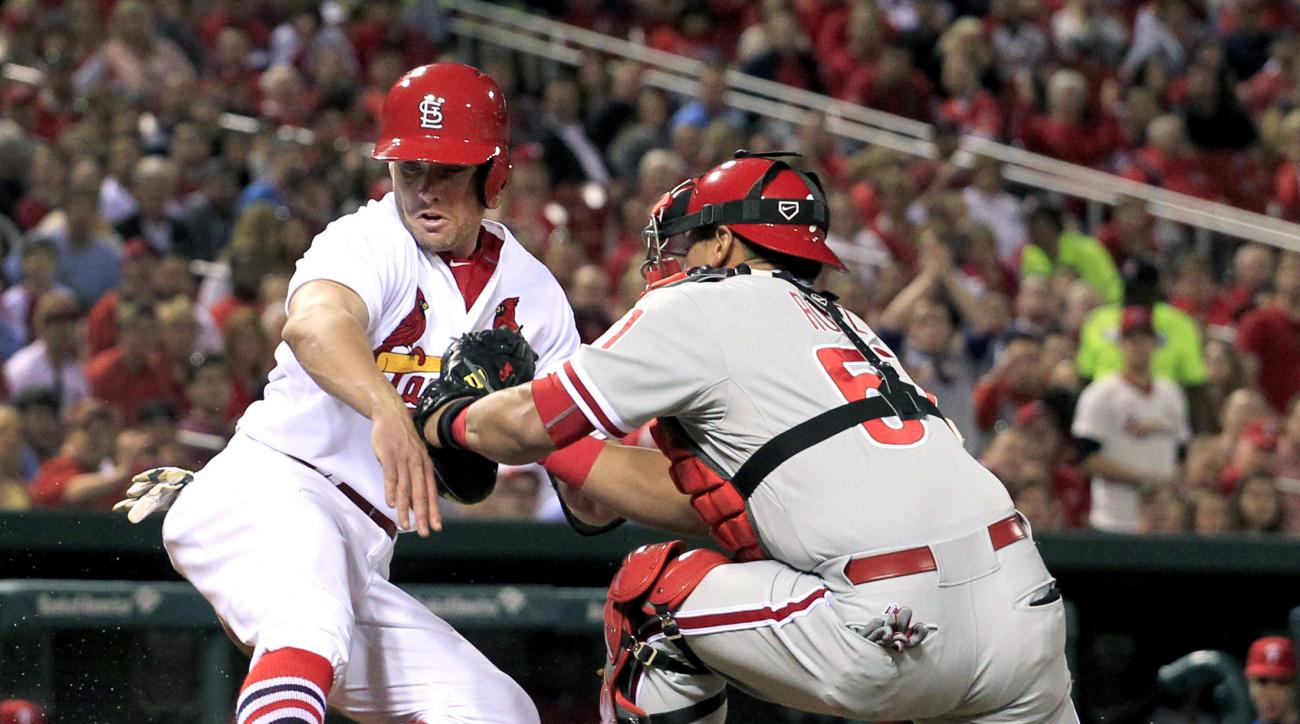 St. Louis Cardinals' Peter Bourjos, left, scores ahead of the tag from Philadelphia Phillies catcher Carlos Ruiz during the fifth inning of a baseball game Wednesday, April 29, 2015, in St. Louis. (AP Photo/Jeff Roberson)