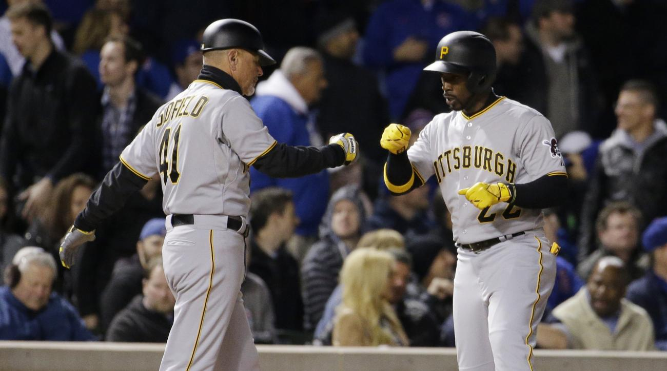 Pittsburgh Pirates' Andrew McCutchen, right, celebrates with third base coach Rick Sofield after hitting a two-run triple during the sixth inning of a baseball game against the Chicago Cubs in Chicago, Wednesday, April 29, 2015. (AP Photo/Nam Y. Huh)