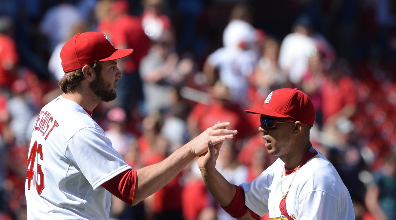 St. Louis Cardinals' Jon Jay, right, and Kevin Siegrist (46) celebrate their 9-3 victory over the Philidelphia Phillies in a baseball game, Thursday, April 30, 2015, at Busch Stadium in St. Louis. (AP Photo/Bill Boyce)