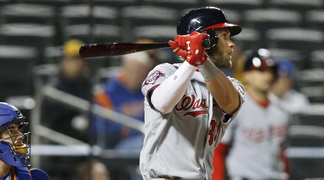 Washington Nationals Bryce Harper hits a ninth-inning, three-run, double in a baseball game against the New York Mets  in New York, Thursday, April 30, 2015. The Nationals defeated the Mets 8-2. (AP Photo/Kathy Willens)