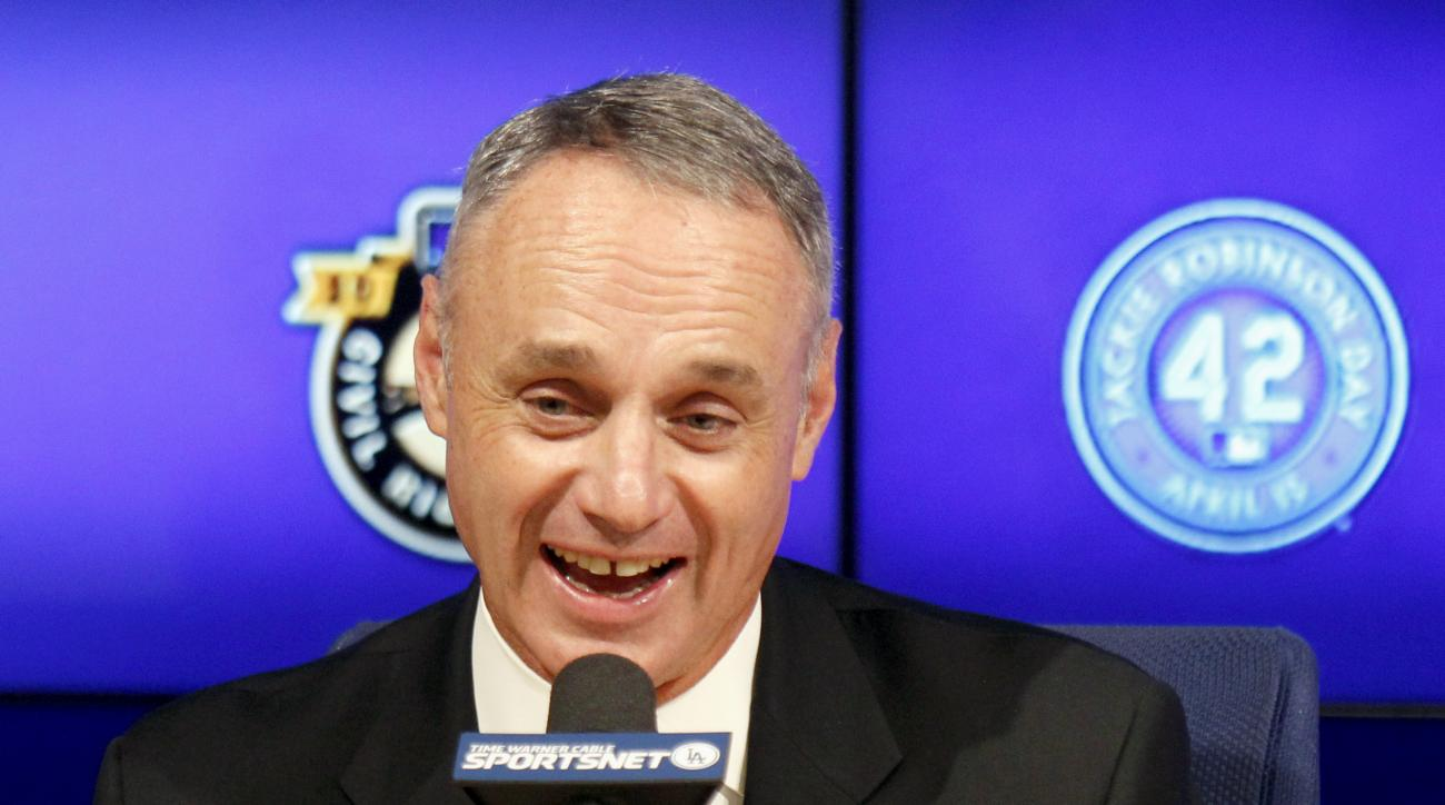 Commissioner of Baseball Rob Manfred talks during a news conference prior to a baseball game between the Los Angeles Dodgers and the Seattle Mariners on Jackie Robinson Day in Los Angeles, Wednesday, April 15, 2015.  Players wore the number 42 to honor th