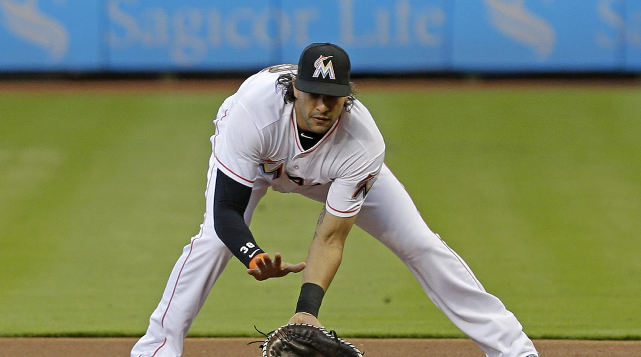 Miami Marlins first baseman Michael Morse fields a ground ball by Philadelphia Phillies' Chase Utley in the first inning of a baseball game Friday, May 1, 2015, in Miami. Utley was out at first base. (AP Photo/Alan Diaz)