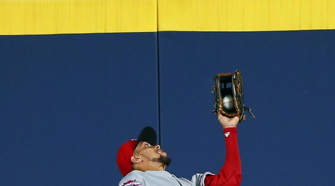 Cincinnati Reds center fielder Billy Hamilton catches a fly ball off the bat of Atlanta Braves' A.J. Pierzynski in the seventh inning of a baseball game Friday, May 1, 2015, in Atlanta. (AP Photo/John Bazemore)