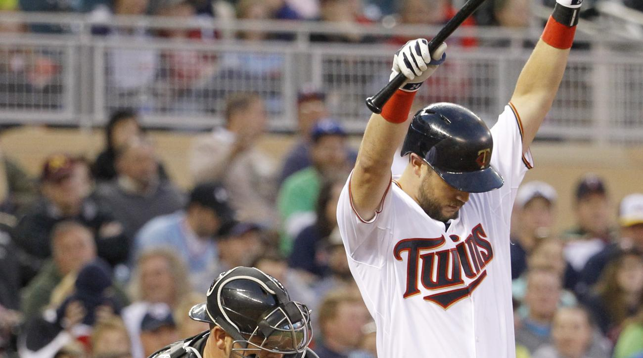 Chicago White Sox catcher Tyler Flowers, left, reaches for a passed ball as Minnesota Twins' Trevor Plouffe, right, tries to get out of the way during the fourth inning a baseball game in Minneapolis, Friday, May 1, 2015. (AP Photo/Ann Heisenfelt)