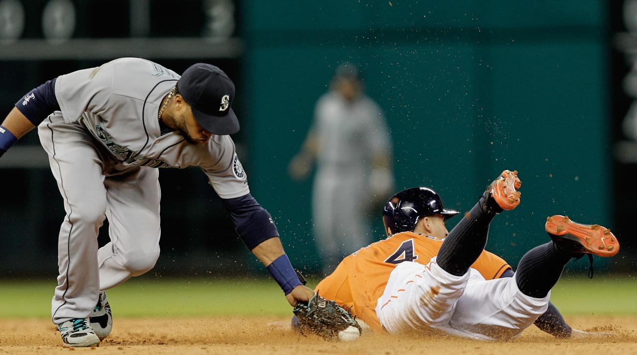 Houston Astros' George Springer (4) slides safely into second base ahead of the tag by Seattle Mariners second baseman Robinson Cano, left, in the fifth inning in a baseball game Friday, May 1, 2015, in Houston. (AP Photo/Bob Levey)