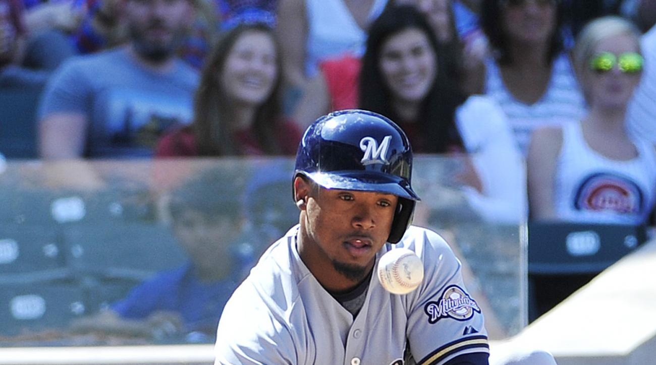 Milwaukee Brewers' Jean Segura attempts a sacrifice bunt against the Chicago Cubs during the seventh inning of a baseball game, Saturday, May 2, 2015 in Chicago. (AP Photo/David Banks)