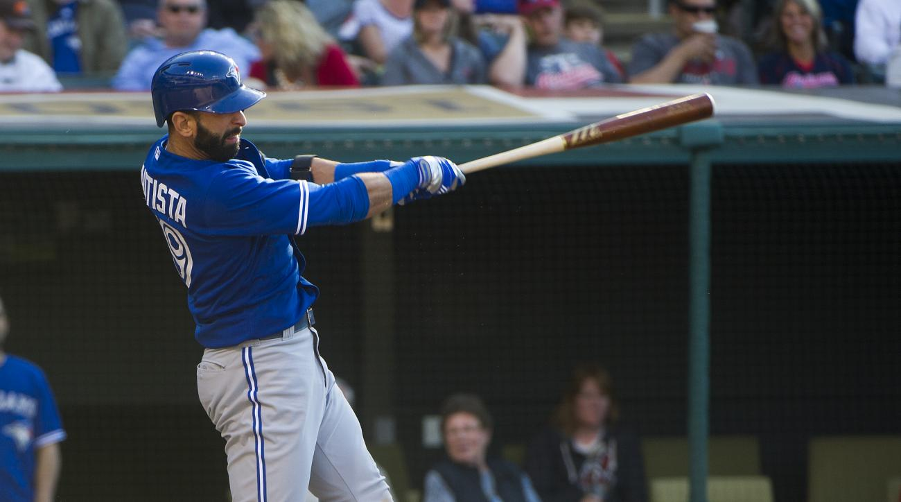 Toronto Blue Jays' Jose Bautista watches his two-run hit off Cleveland Indians' pitcher Anthony Swarzak during the sixth inning of a baseball game in Cleveland, Saturday, May 2, 2015. (AP Photo/Phil Long)