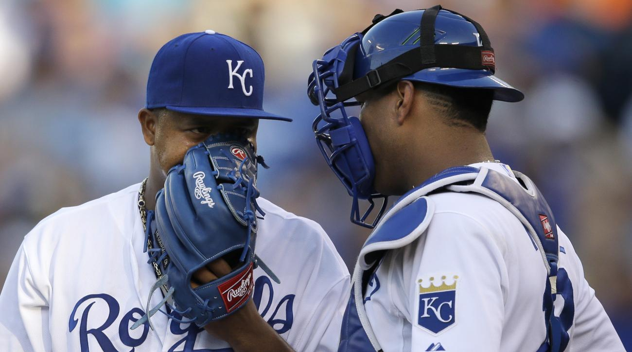Kansas City Royals starting pitcher Edinson Volquez (36) talks with catcher Salvador Perez, right, after giving up a run in the third inning of a baseball game against the Detroit Tigers at Kauffman Stadium in Kansas City, Mo., Saturday, May 2, 2015. (AP