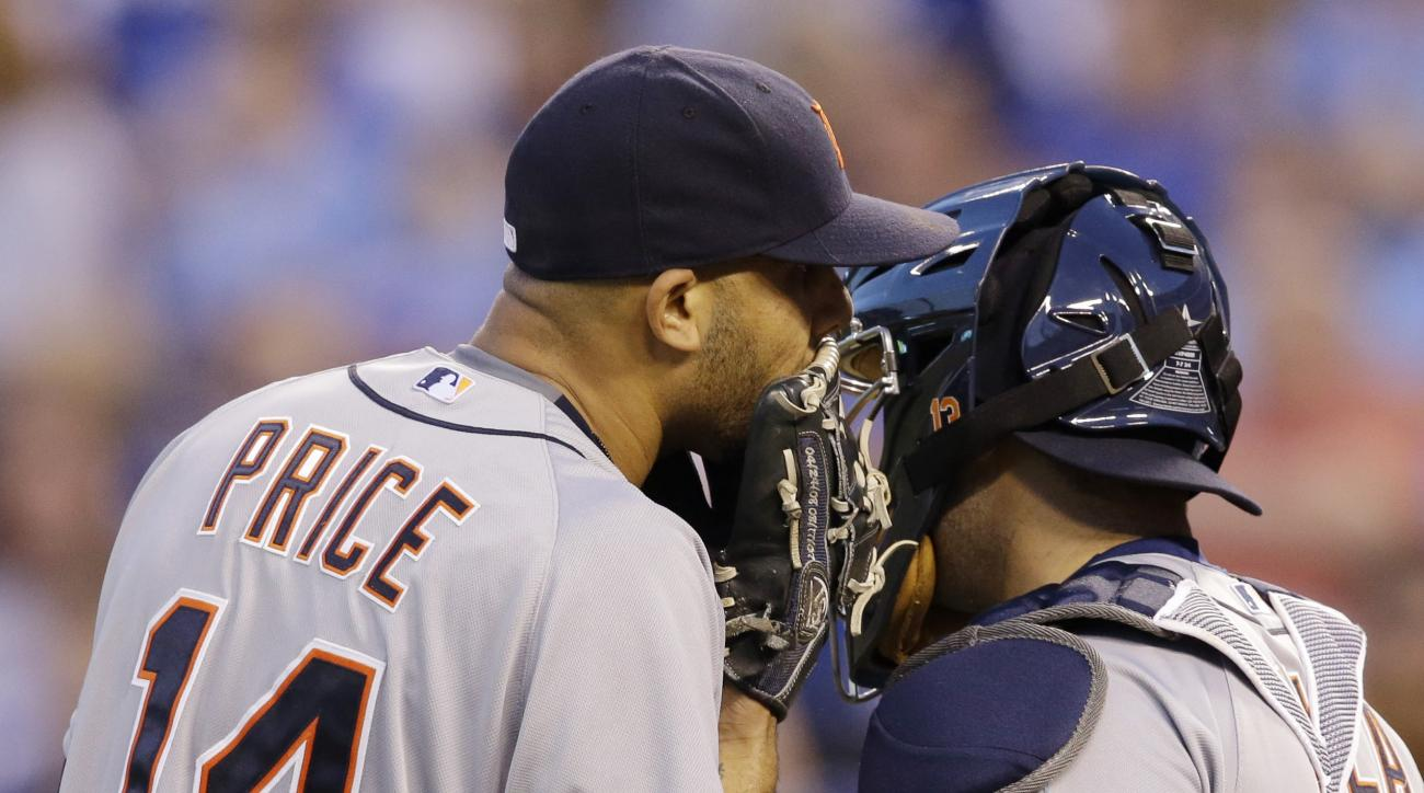 Detroit Tigers starting pitcher David Price (14) talks with catcher Alex Avila (13) during the sixth inning of a baseball game against the Kansas City Royals at Kauffman Stadium in Kansas City, Mo., Saturday, May 2, 2015. The Tigers defeated the Royals 2-