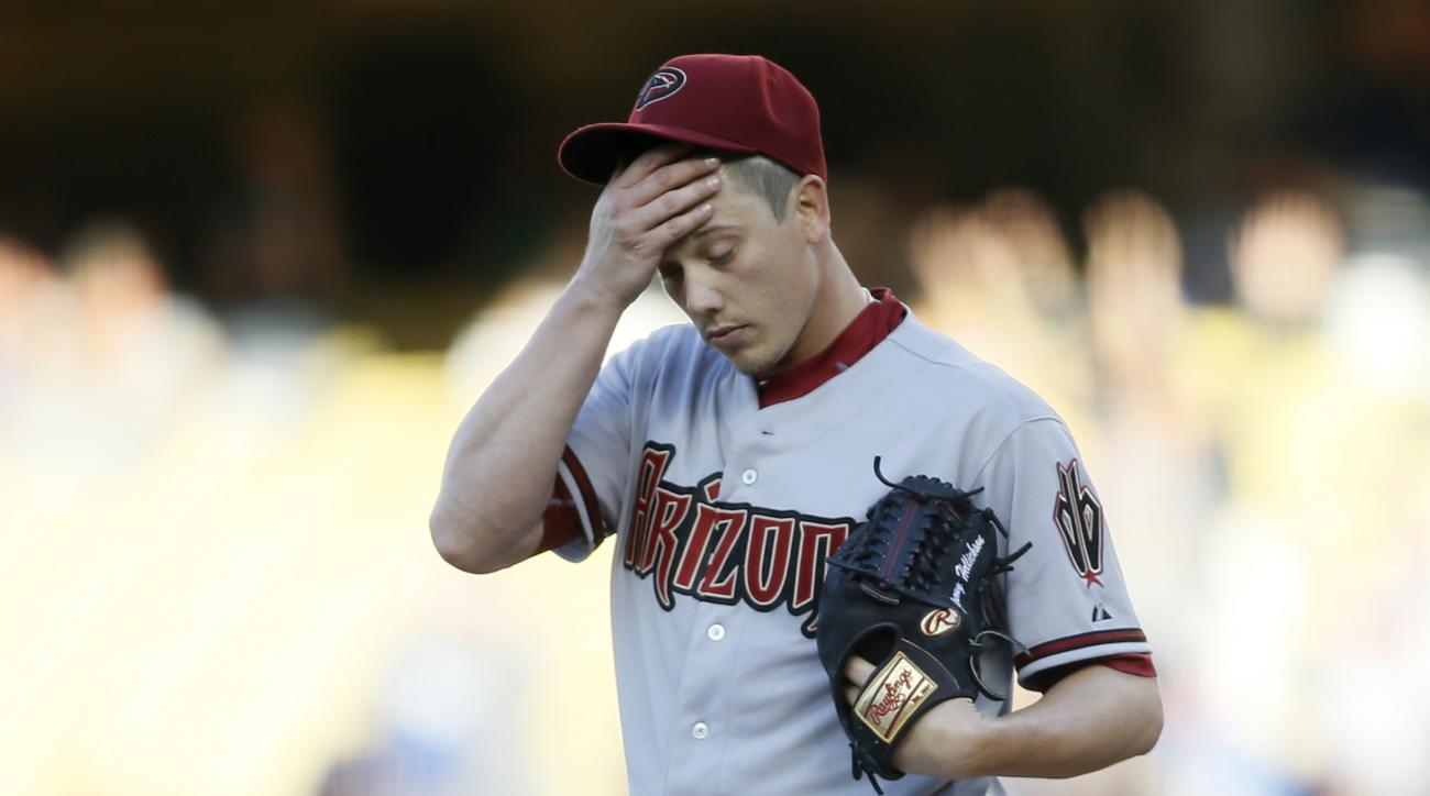 Arizona Diamondbacks starting pitcher Jeremy Hellickson reacts after giving up a home run to Los Angeles Dodgers Justin Turner during the first inning of a baseball game, Saturday, May 2, 2015, in Los Angeles. (AP Photo/Danny Moloshok)